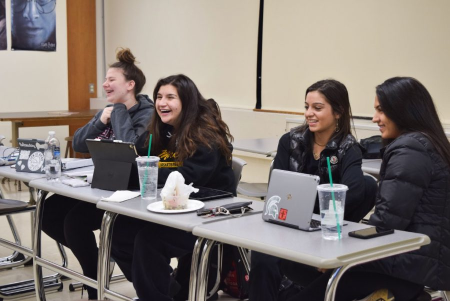 Members of Mercy's mock trial team gather to discuss different topics concerning their case. Photo by Rachael Salah