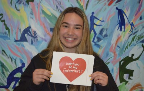 Junior Gabi Michallef poses with a candy gram she made to give away to a friend on Galentine's Day. Photo by Clare Jones