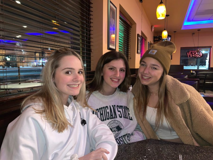 "Left to right: Juniors Avery Swickard, Paige Waiduck, and Lily Waldman enjoying their ""Galentine's Day"" dinner together. Photo by Delilah Coe"