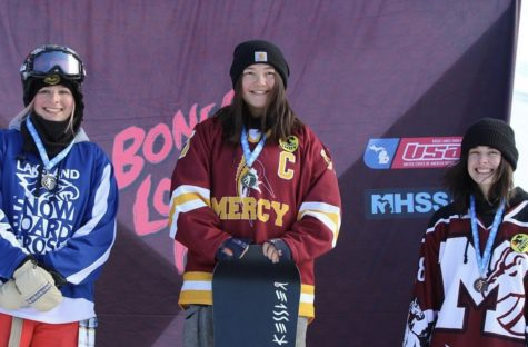 Senior Sam Fee standing on the podium after receiving her gold medal for a boarder cross state championship. Photo used with permission from Sam Fee