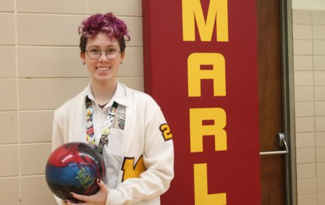 Maddie Briggs stands proudly with the bowling ball she used to help the Mercy bowling team win the Catholic League Championship. Photo by Clare Jones