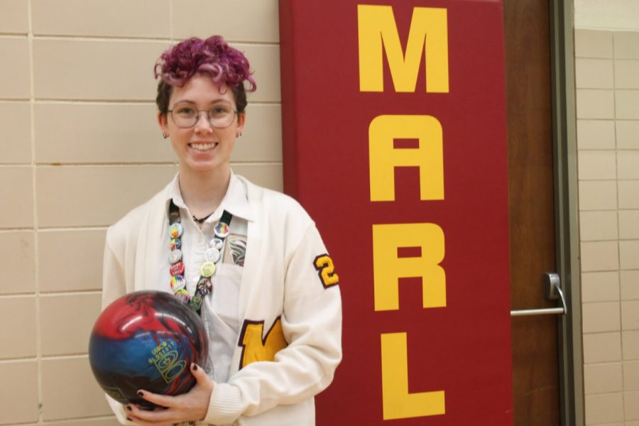 Maddie+Briggs+stands+proudly+with+the+bowling+ball+she+used+to+help+the+Mercy+bowling+team+win+the+Catholic+League+Championship.+Photo+by+Clare+Jones