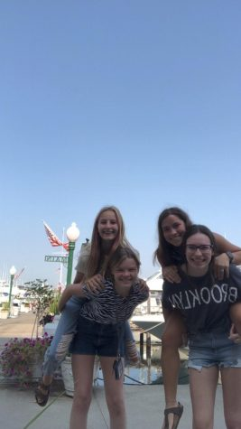 Junior Sadie MillerWright and her friends pose at the Detroit Yacht Club on their Wednesday off.
