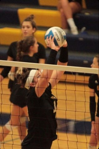 Senior Julia Bishop goes to set the ball for a teammate.