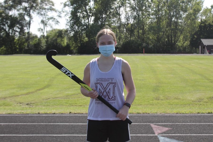 "Junior Riley Condon begrudgingly wears her mask as she practices for Mercy's Varsity Field Hockey team to protect herself and her teammates. ""I obviously wear [a mask],"" said Condon. ""I don't mind wearing one on the sidelines, but when running and doing physical activity, I would of course prefer not to wear one."""